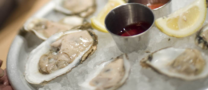 Take a Break From Holiday Insanity With 'Bags & Bubbles' at Oyster House