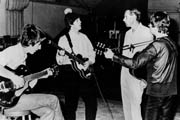 Video: Watch Legendary Beatles Producer Sir George Martin Mix a Perfect Martini