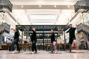 Rise & Drink with The Bourse's Sweat + Sip Yoga Series Every Saturday Morning