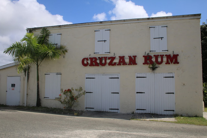 The scent of molasses is already in the air as we pull into the front gate  of Cruzan headquarters  a collection of brightly colored buildings just off  the. Enjoy History and Drinking on the Cruzan Rum Distillery Tour